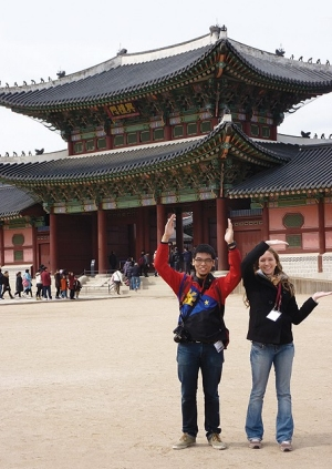 Standing in front of the Gyeongbokgung Palace in Seoul are UC students Carlo Cruz and Sarah Brown.   They and George Hakim were the only UC students selected to participate in the South Korea   Scholarship Program offered by the Council on Inter-national Educational Exchange in March 2011.   They studied at Yonsei University and traveled to historic sites. This spring, Brown is in Europe   as part of her Lindner Honors-PLUS requirements.