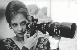Gina Lollobrigida witih a long-lensed camera