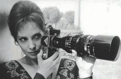 Gina Lollobrigida witih a long-lensed camera