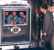 President Richard Nixon visits Armstrong and his crew while they are in quarantine.