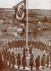 Circle of women saluting the flag.