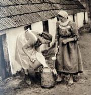 Helping the farmer's wife.