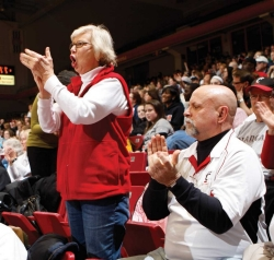 Pat Neidhard and her husband Jim cheering on the Bearcats from the stands inside Fifth Third Arena.