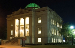 The colorful dome of Van Wormer Library lit up at night.