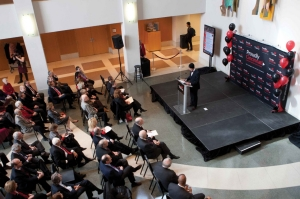 An aerial view of a crowded room during the annoucement