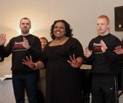 Three students singing.