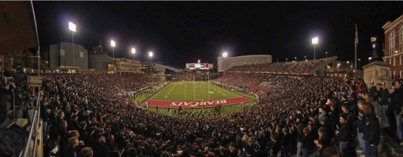 an aerial view of Nippert Stadium at night during a football game