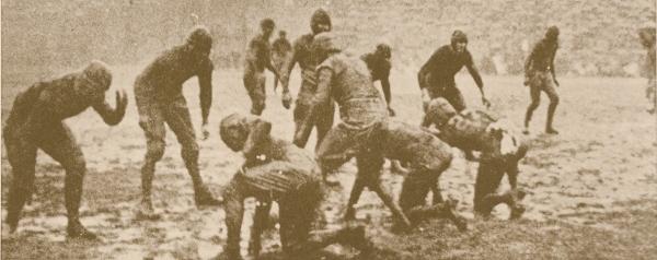 Muddy football field 1923