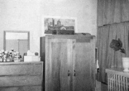 A Ludlow Hall dorm room, showing a wardrobe and dresser.