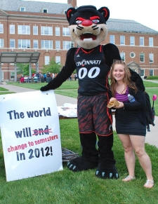 "The Bearcat holds a sigin reading, ""The world will change to semesters in 2012."""