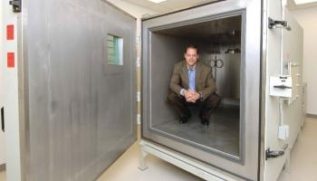Alex Lentschan inside a large altitude chamber.