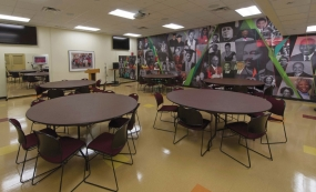 Renovated space at the AACRC -- chairs, tables and the memory wall.