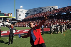 Launching T-shirts into the student section at athletics events is just one way UC's new leader connects with his favorite constituents. He's also been known to drop by to practice with the football and basketball teams. photo/