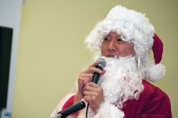 "UC students revealed their belief in ""Santa"" when they came to a Student Government-sponsored holiday event inside Tangeman University Center for songs, hot chocolate and pictures with UC's top elf. President Ono so embraces the role that he owns the suit. photo/Dottie Stover"