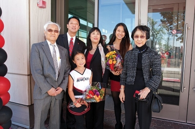 UC's new president pauses with his family soon after UC's Board of Trustees formally installed him as the university's 28th president. Standing with him, from left, are his father (Takashi), daughter (Sarah), wife (Wendy Yip), daughter (Juliana) and mother (Sachiko). photo/Dottie Stover