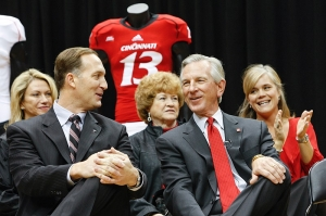 Athletics Director Whit Babcock chats with Tommy Tuberville during the press conference. photo/Lisa Ventre