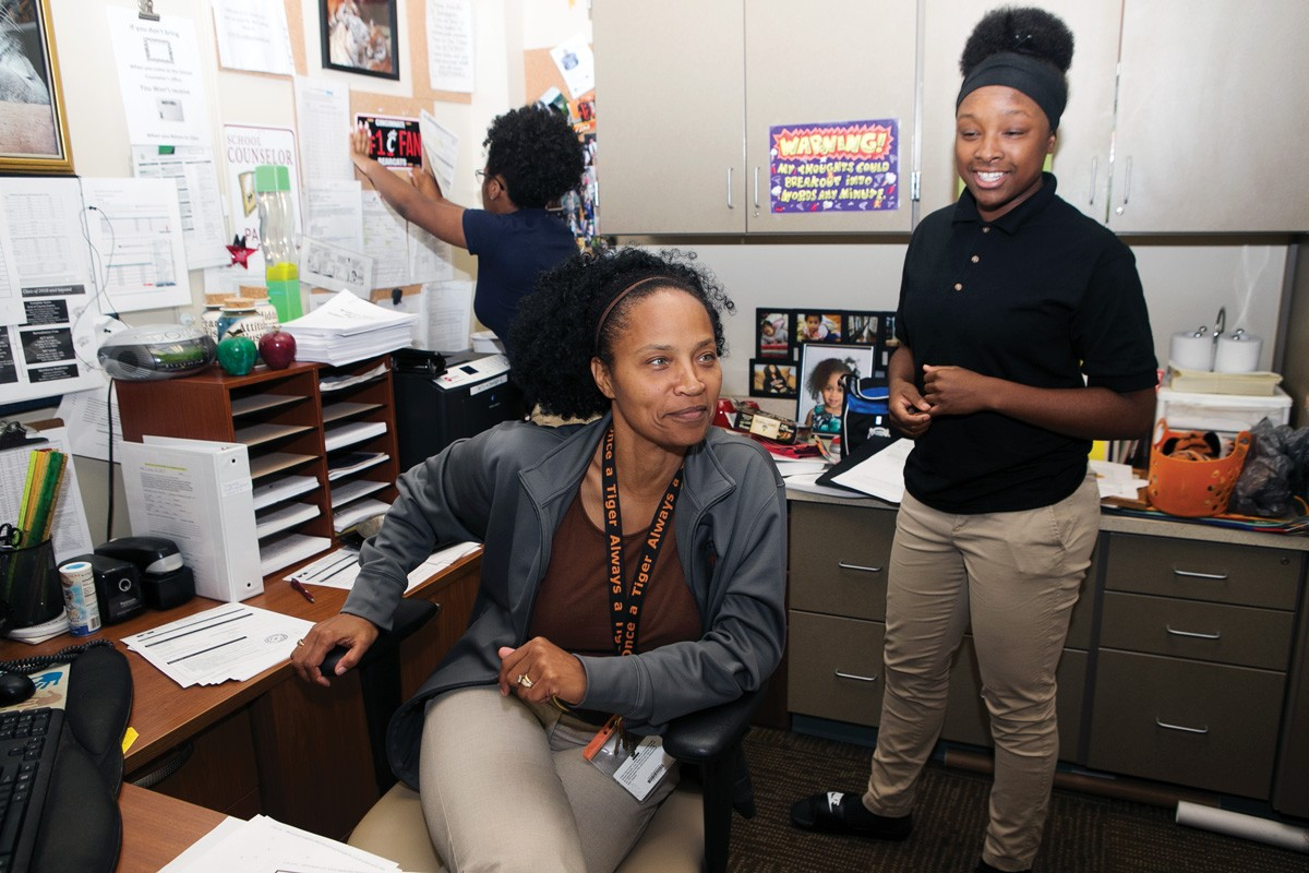 Tracey Williams, Nya Williams and Te'A Freeman in the guidance counselor's office