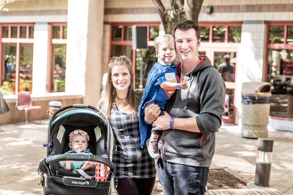 Dana and Greg Hill with their children stand outside
