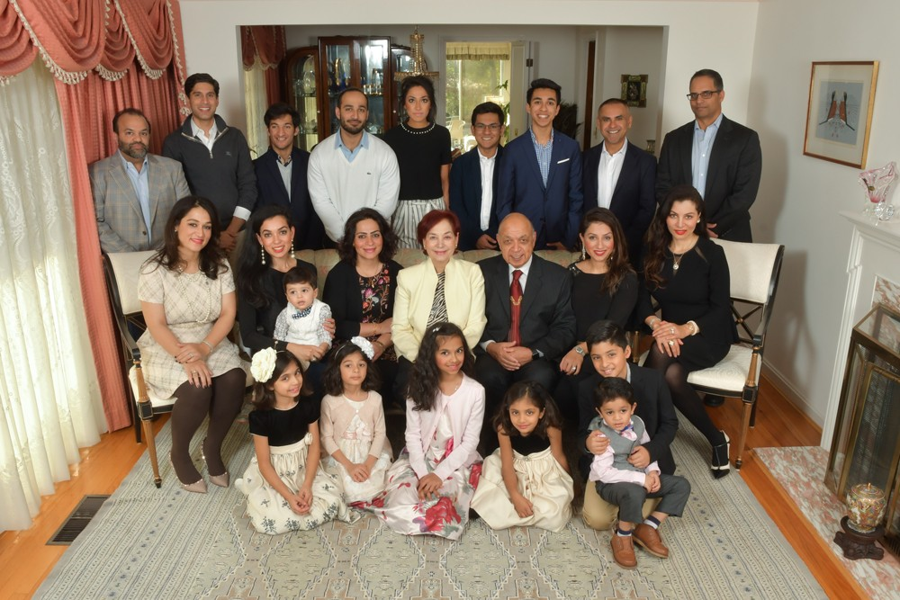 Inayat and Ishrat Malik, seated at center and surrounded by members of their family