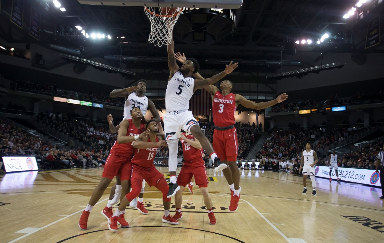 UC Men's Basketball team competes for a rebound against the University of Houston