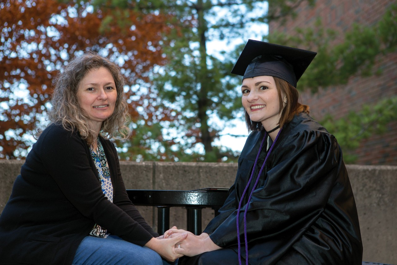Tori Thomas and her mom, Melissa Caldwel sit outside UC's Geo-Physics building.