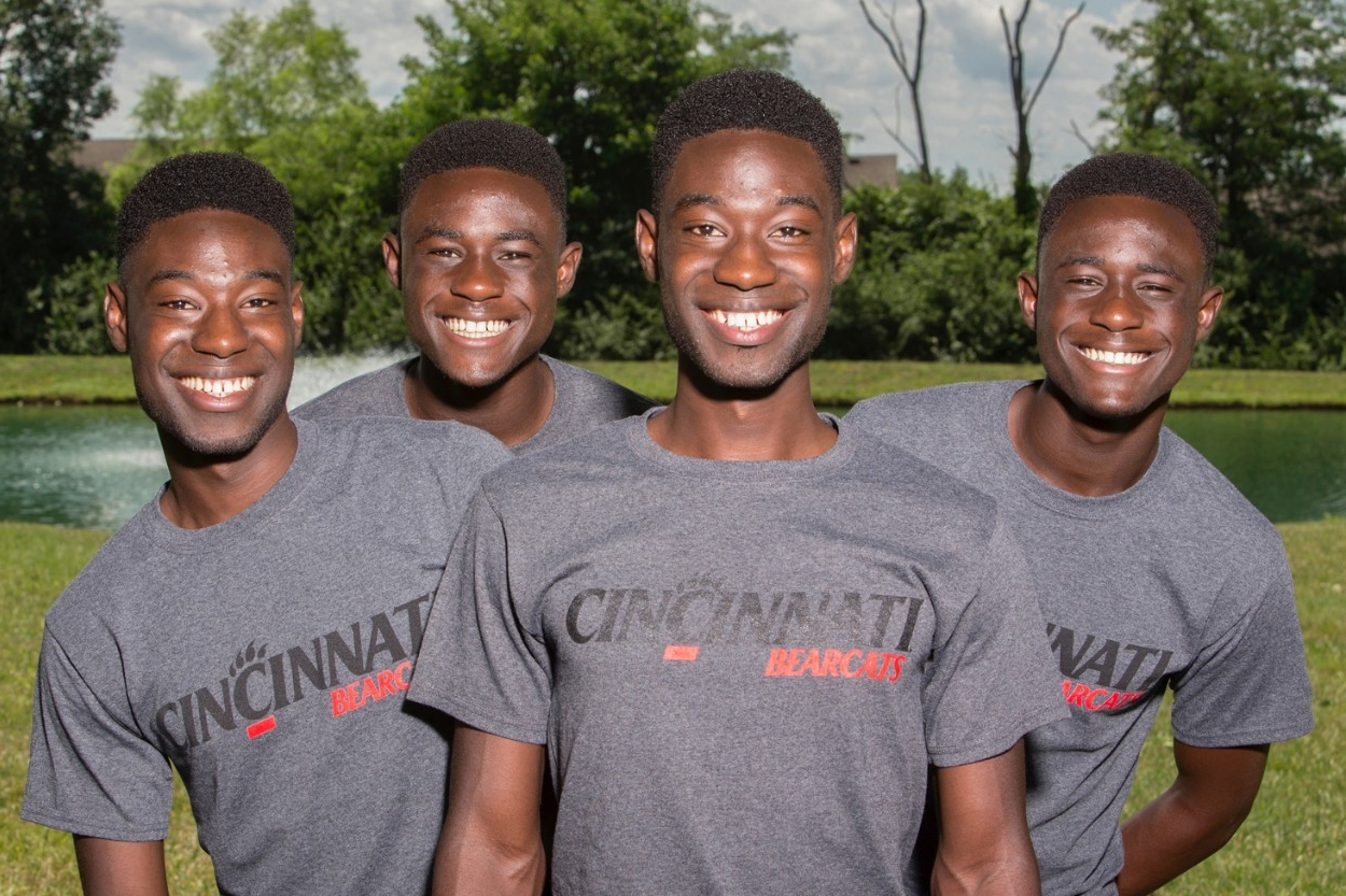 The Mantey brothers - two sets of identical twins from the same family - pose in their UC gear
