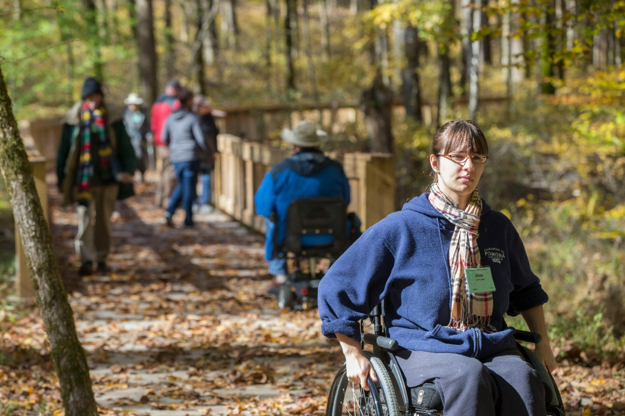 Alida Schefers explores a hiking trail from her wheelchair