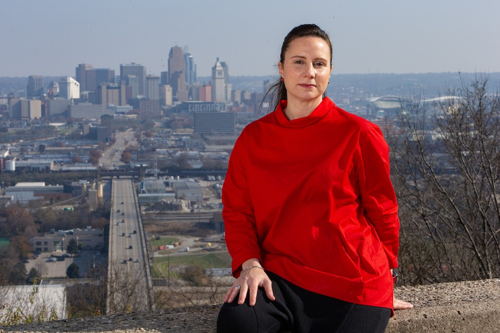 DAAP Associate Professor Claudia Rebola stands near an overlook of the city of Cincinnati