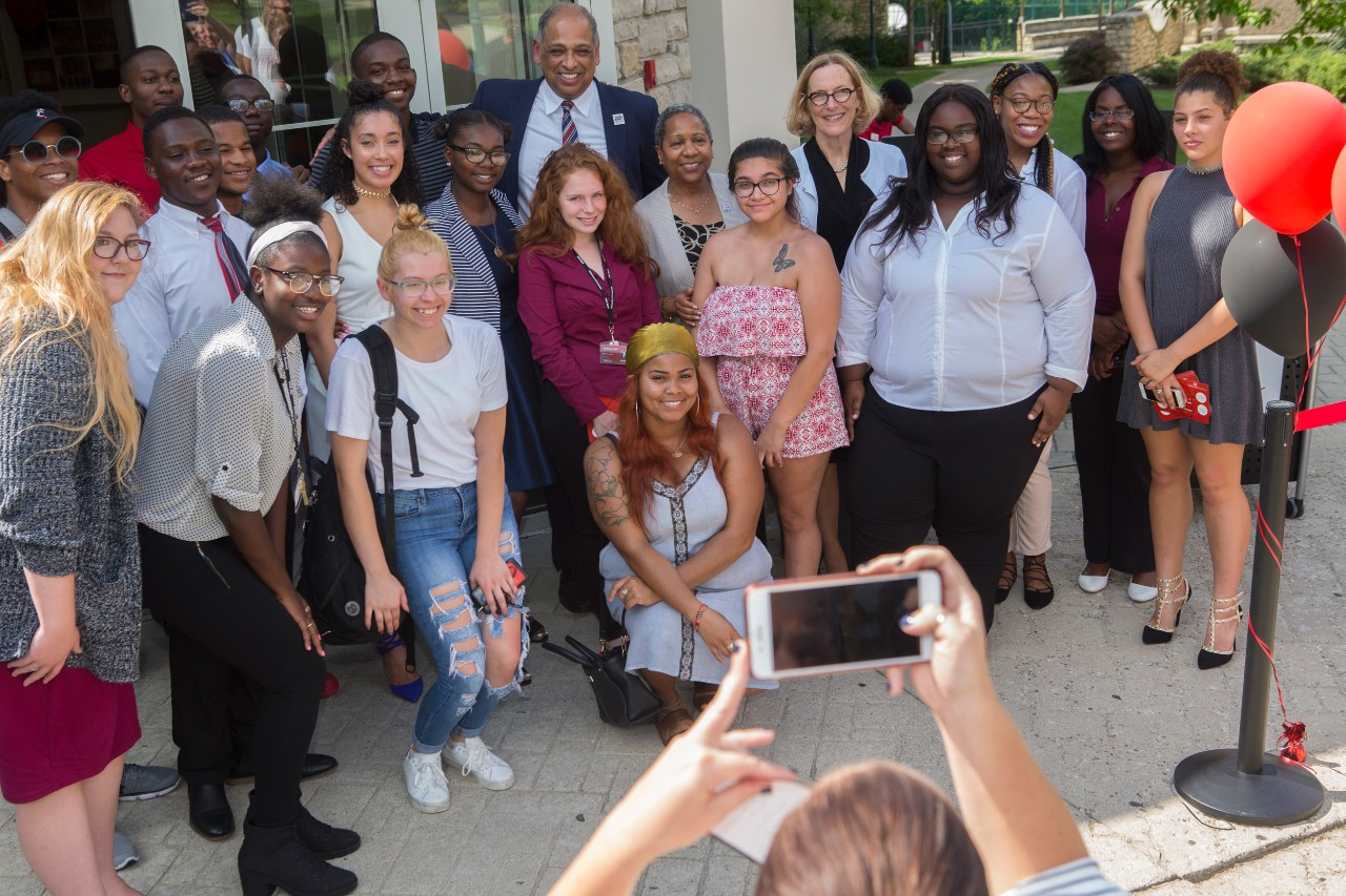 Members of the Gen-1 Theme House pose with UC's President Neville Pinto