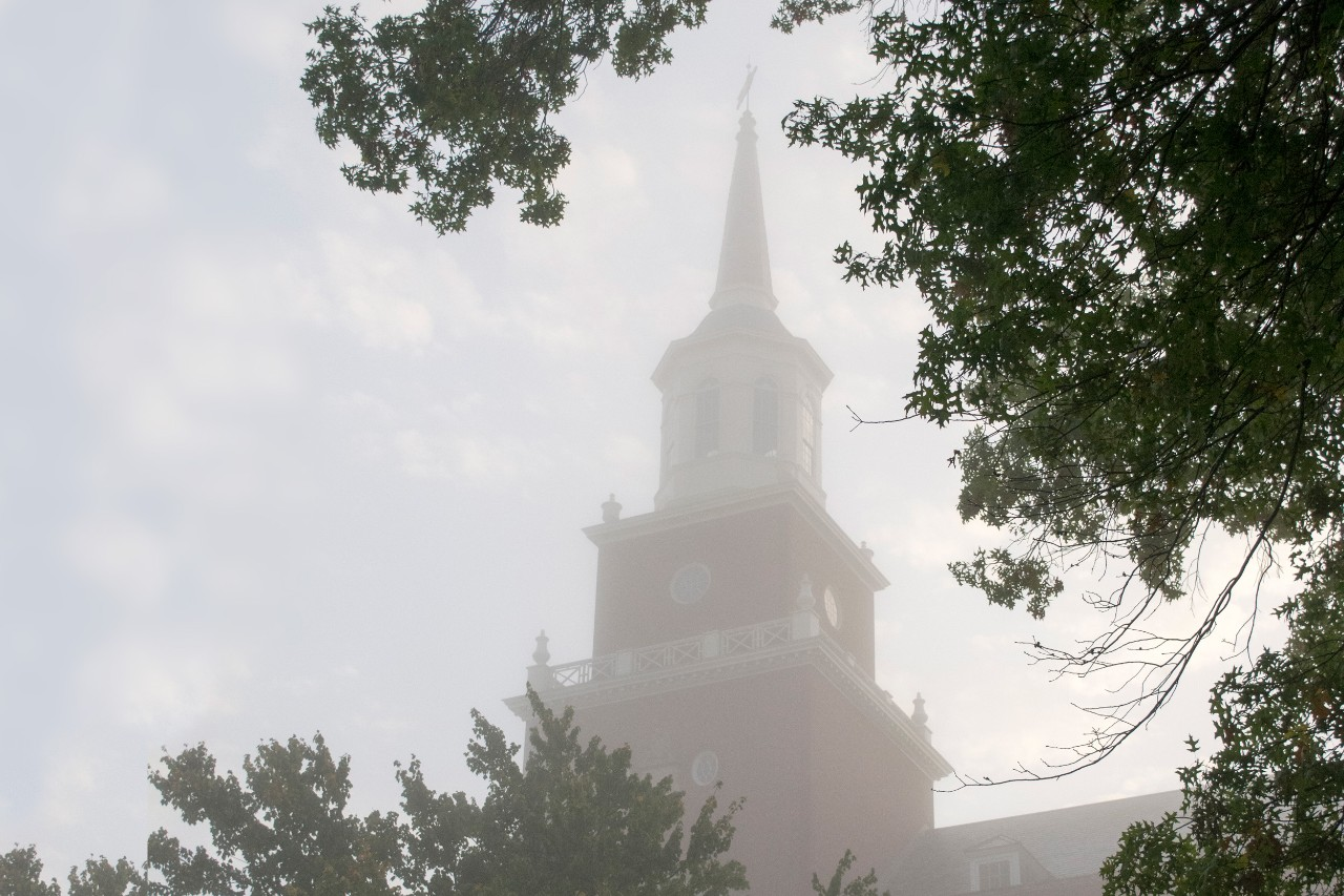 The spire of McMicken hall in a morning fog