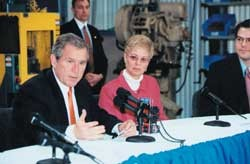 President Bush, Carolyn Renninger and her son, Geoff Taylor, have a press conference at the family's manufacturing plant in Pennsylvania. photo courtesy of Carolyn Jentzen Taylor Renninger