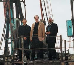 UC alumnus Rodger Henn (center) toured an oil rig anchored in the Caspian Sea near Baku, Azerbaijan, along with the president and director of the company that he had been advising.