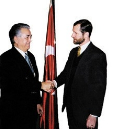 Brian MItchell greets Turkish ambassador Faruk Logoglu, left.