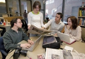 The News Record office has moved around to at least five different locations since the '70s, but in 2004, staff members moved into quarters especially designed for them in Swift Hall, complete with wireless Internet access. Staff members in the spring of 2006 include, from left to right, photo editor Dan Burns, editor-in-chief Julie Hollyday, managing editor Michael Rovito and entertainment editor Laura Sayer. photo/Andrew Higley