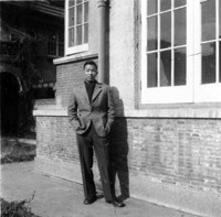 At age 16, Frank poses outside the solarium of his family's home. A year later, he would leave China to find freedom.