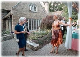 A university presidency quickly becomes a family affair in many ways. Hosting dinners and receptions at the family's home is just one of them. In June, the Stegers' backyard took on a South American carnival theme to honor UC benefactors. Here, Sonia Koschoreck dresses appropriately to welcome guests.