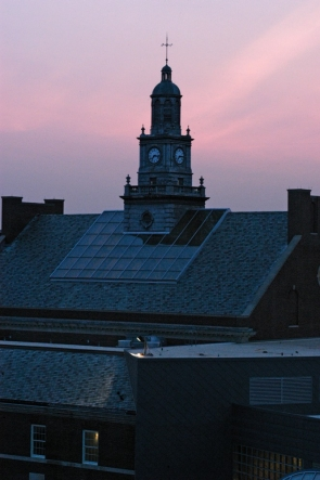 A pink sky lights the Tangeman University Center clocktower at the University of Cincinnati at sunrise.