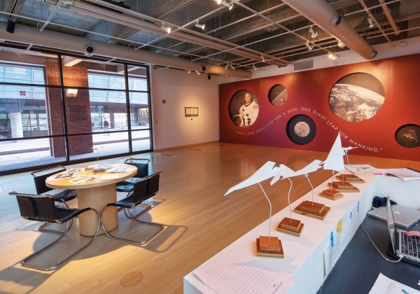 This art and artifact gallery is cozy and offers a table for studying.