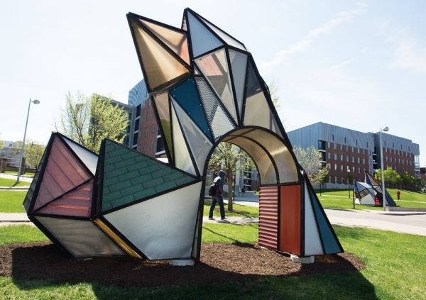 An outdoor sculpture called Crystal Garden looks like a stained glass window that's been shaped to a point.