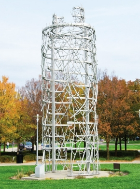 A sculpture of twisting silver metal creates a tower and details elicit blood vessels.