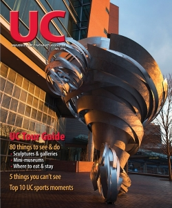 "Cover of July 2014 issue features ""Super Twister,"" a tornado sculpture near the CARE/Crawley building."