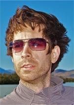 A portrait of Brian Leitten in sunglasses