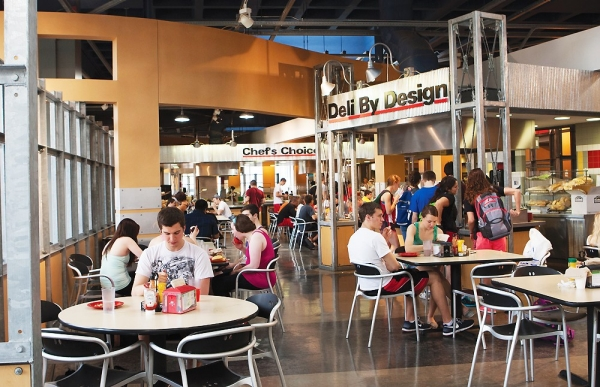 Full round dining tables and a busy atmosphere are at the University of Cincinnati's MarketPointe.
