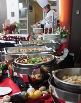 Open buffet chafing dishes show a large variety of food.