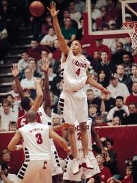 Former UC Bearcats basketball star Kenyon Martin stretches out to block a shot.