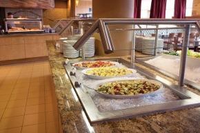 Many chafing dishes line the extensive breakfast and gourmet lunch buffet.