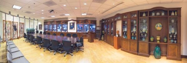 A highlight of the Stanley Lucas Board Room is a collection of antique Cantagalli jars, pictured in the cabinets.