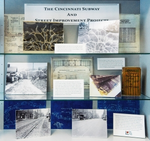 "These photos in a display case in UC Archives and Rare Books are just a few of the photos and materials of  ""The Cincinnati Subway and Street Improvement Projects."""
