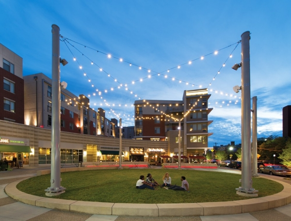 Tiny white lights criss-cross above a grassy circle in the new U-Square area near the University of Cincinnati