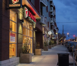 A revitalized nearby street has new buildings, restaurants and activities.
